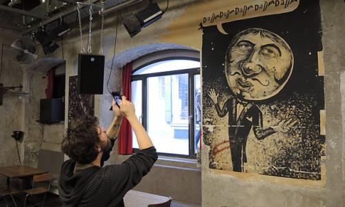 Man taking photos inside Cabaret Voltaire.
