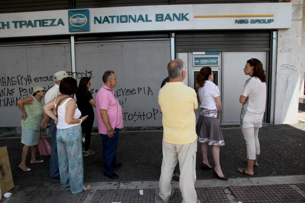 "GREECE-ATHENS-BAILOUT<br />06 Jul 2015, Athens, Attica, Greece — (150706) — ATHENS, July 6, 2015 (Xinhua) — Greek pensioners without bank cards line up outside bank to withdraw up to 120 euros for the week, in Athens, July 6, 2015. Greek President Prokopis Pavlopoulos convened political leaders for a meeting to design new strategy after the no victory in the July 5 referendum on bailout terms. (Xinhua/Marios Lolos) (dzl) — Image by © Marios Lolos/Xinhua Press/Corbis"" width=""1000″ height=""667″ class=""gu-image"" /><br /> <figcaption> <span class="