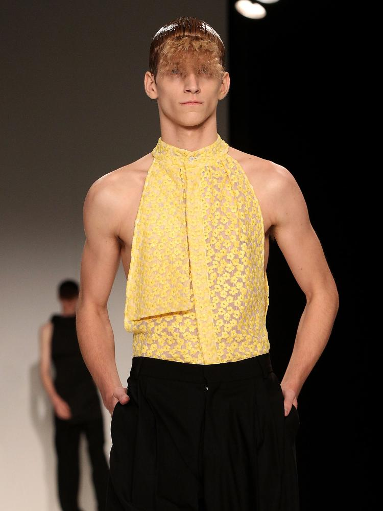 Men in blouses on the J.W. Anderson catwalk in 2013