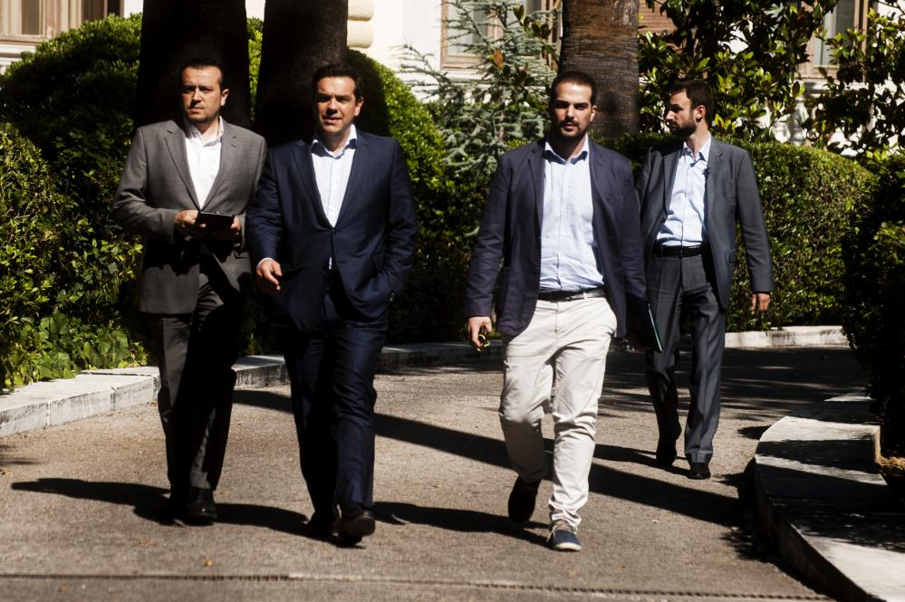 Greek Prime Minister Alexis Tsipras (C) Minister of State Nikos Pappas (L) and Government spokesman Gavriil Sakellaridis (2-R) leave the Presidential Palace after a meeting with party leaders in Athens on July 6, 2015. Germany dismissed Greece's bid to clinch a quick, new debt deal after the country delivered a resounding 'No' to more austerity measures, appearing little moved by the surprise resignation of the Greek finance minister.IAKOVOS HATZISTAVROU/AFP/Getty Images