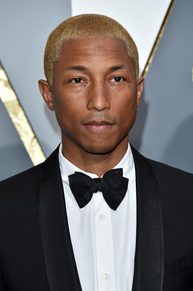 Pharrell with his bleached do.