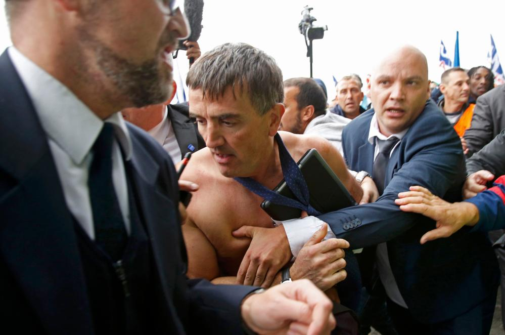 "Xavier Broseta, Executive Vice President for Human Resources and Labour Relations at Air France, is evacuated by security after employees interrupted a meeting at the Air France headquarters building in Roissy<br />A shirtless Xavier Broseta (C), Executive Vice President for Human Resources and Labour Relations at Air France, is evacuated by security after employees interrupted a meeting with representatives staff at the Air France headquarters building at the Charles de Gaulle International Airport in Roissy, near Paris, France, October 5, 2015."" width=""1000″ height=""662″ class=""gu-image"" /><br /> <figcaption> <span class="