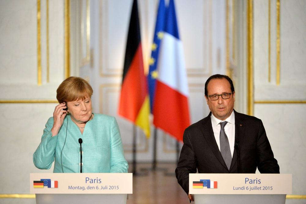German Chancellor Angela Merkel makes a statement with French President Francois Hollande during a press conference after their meeting at the Elysee Palace on July 06, 2015 in Paris, France. Angela Merkel met Francois Hollande to discuss Greece's situation in the European Union in a post-referendum environment.