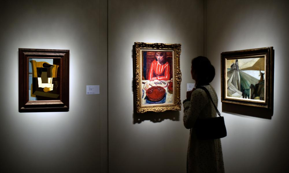A viewer looks at the collection of A Alfred Taubman at Sotheby's on October 24, 2015 in New York City.