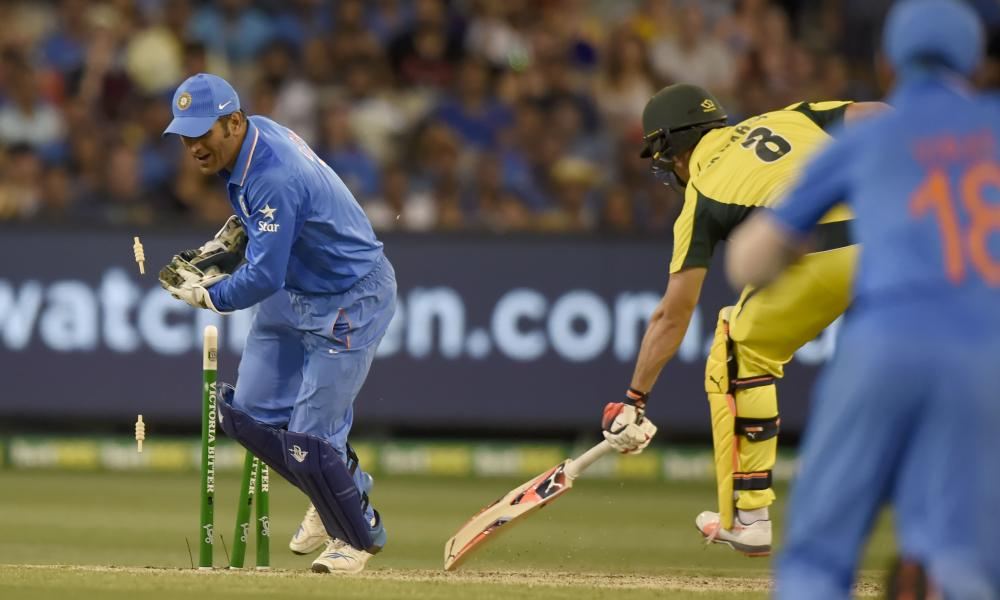 India'€™s MS Dhoni takes the bails as Mitchell Marsh perishes to a dreaded run-out.