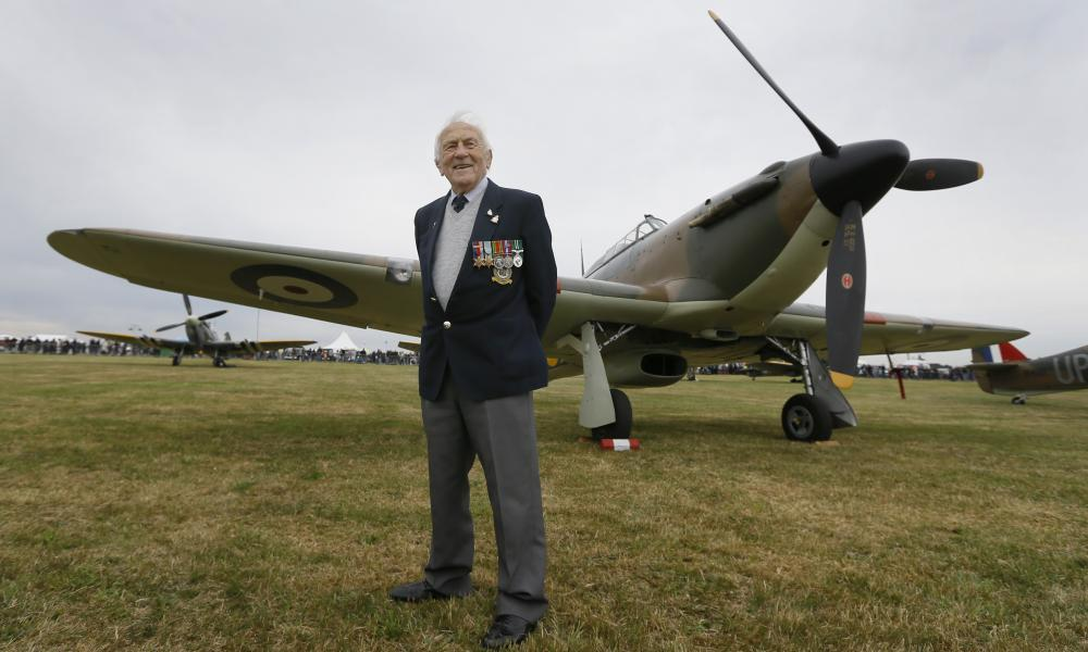 Veteran RAF pilot Tony Pickering stands with a Hurricane before takeoff.