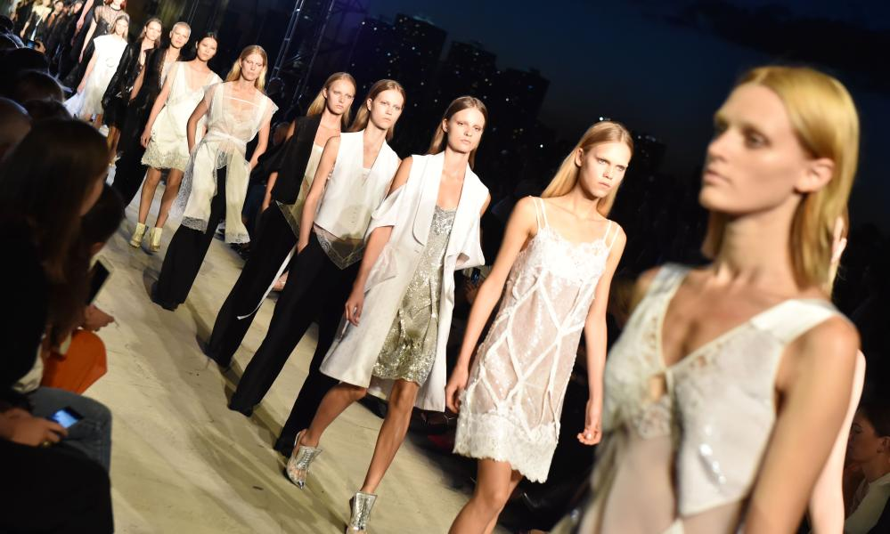 Models wear lace slips on the catwalk for the Givenchy show.