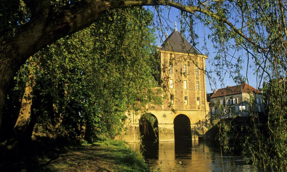 Ancient water mill over the Meuse River housing the Rimbaud Museum, France