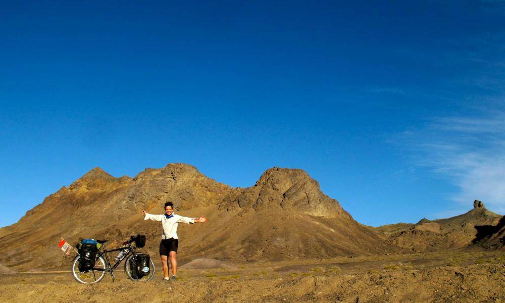 Sarah Outen and her bicycle in the Gobi Desert, Mongolia.