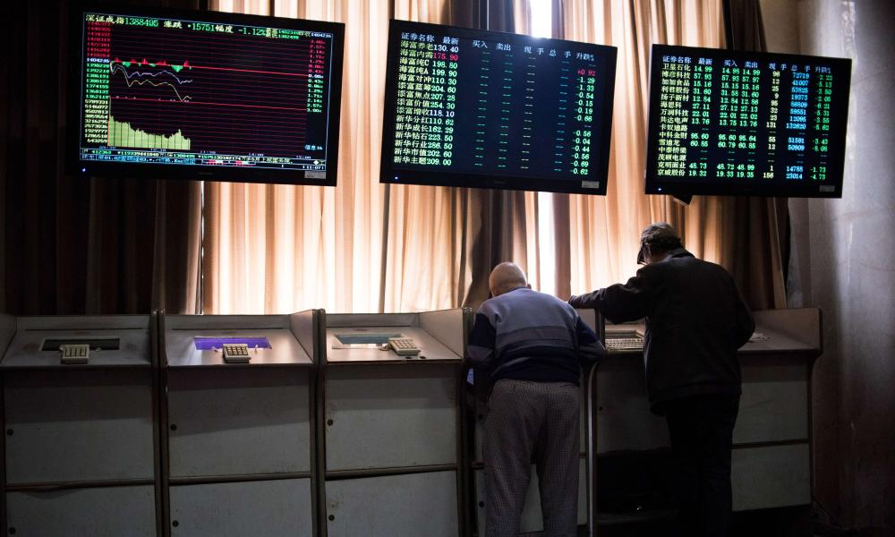 Chinese investors look at prices of shares and the Shanghai Composite Index at a stock brokerage house in Shanghai today.