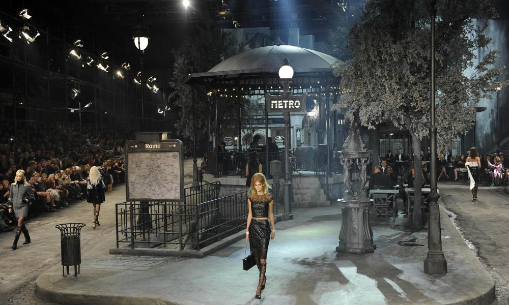 Models present the Paris-Rome 2015/16 creations by German designer Karl Lagerfeld for Chanel