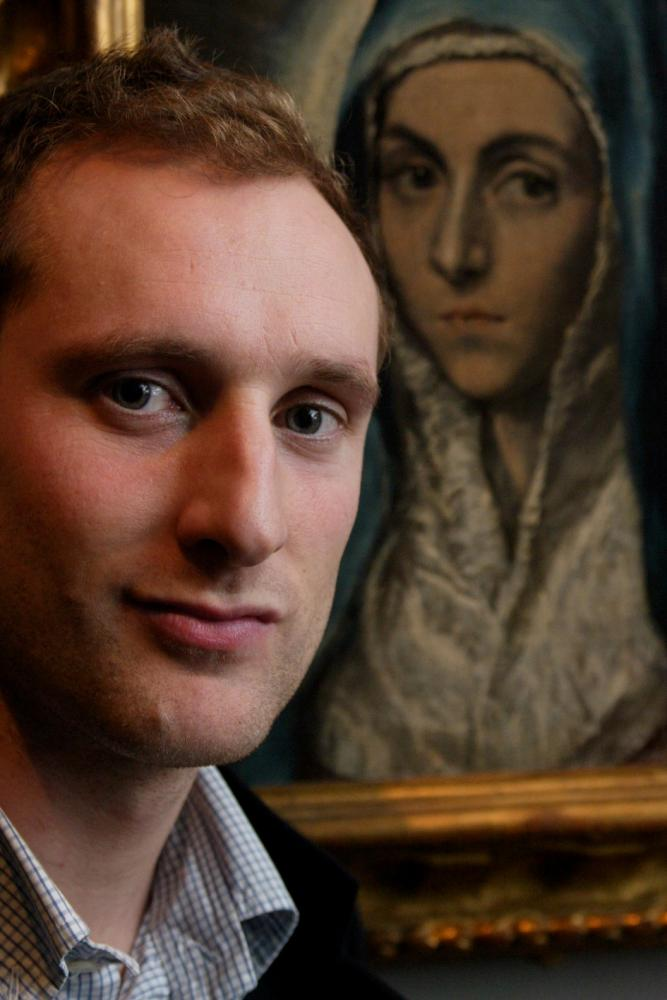 Xavier Bray, curator, with El Greco's Madonna from Strasbourg in the background.