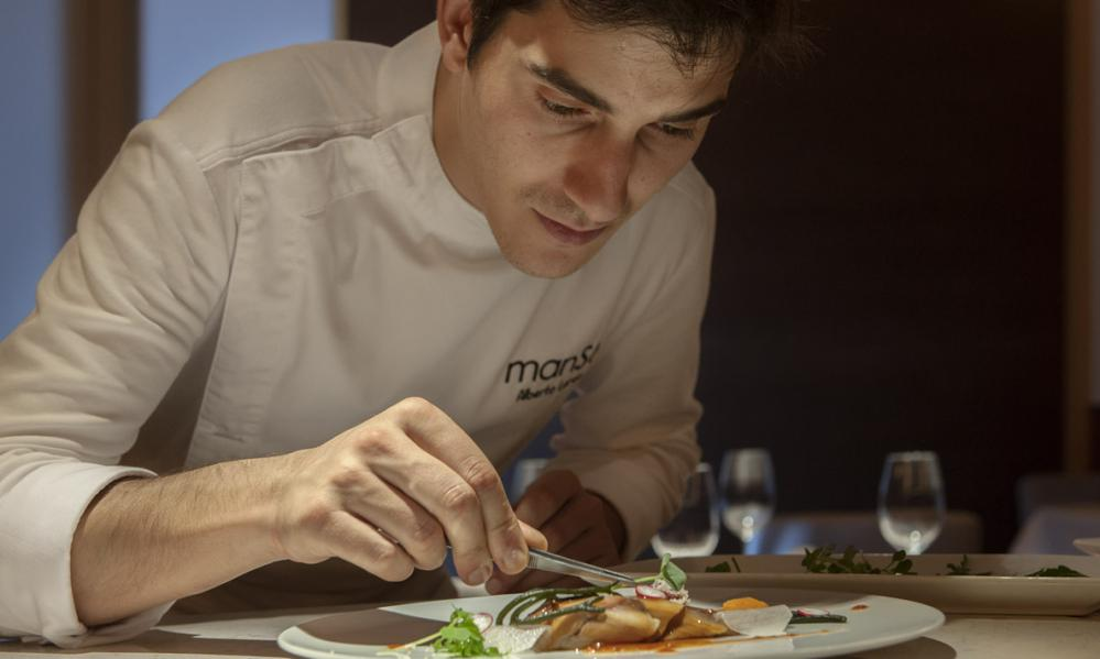 Chef Alberto Lareo plates a meal at his restaurant, Manso.