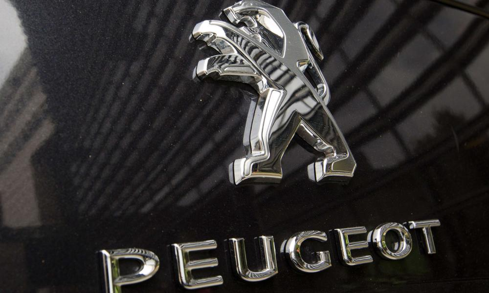 (FILES) - The logo of French car maker PSA Peugeot is seen on a car parked in front of French Economy minstry (left) in Paris, on September 11, 2012. French auto giant PSA Peugeot Citroen's worldwide sales in 2012 dropped by 16.5 percent in 2012 due to contracting demand in debt-crippled southern Europe and the suspension of its activities in Iran, it said in a statement on January 9, 2013. AFP PHOTO JOEL SAGETJOEL SAGET/AFP/Getty Images
