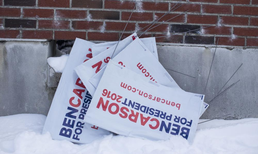 Signs for Republican presidential candidate Ben Carson in the snow outside the polling place at the Webster School in Manchester, New Hampshire.