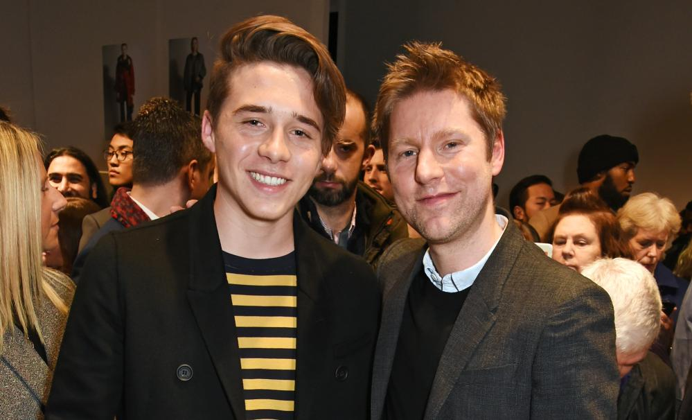 Brooklyn Beckham (left) and Christopher Bailey at Burberry's AW16 show in January.