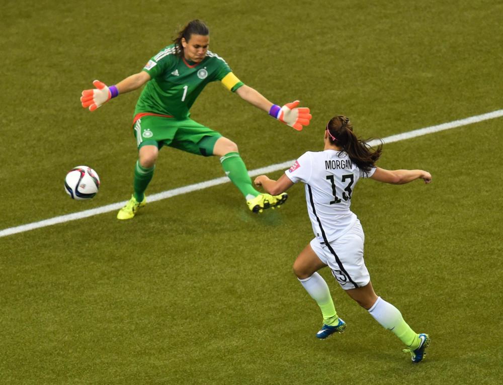 Germany's goalkeeper Nadine Angerer blocks a shot from Alex Morgan.