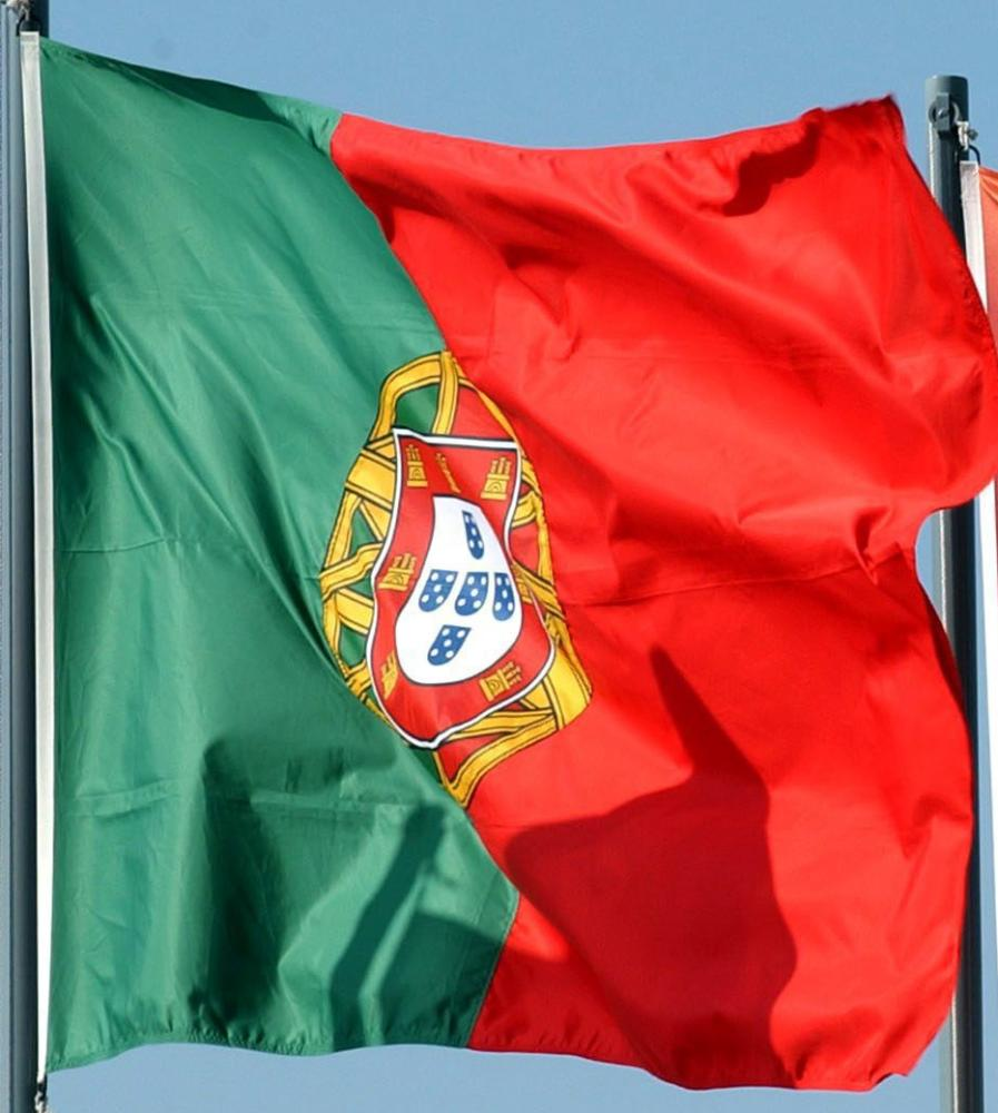 The national Portuguese flag is hoisted next to the Euro 2004 flag<br />epa000207050 The national Portuguese flag is hoisted next to the Euro 2004 flag as the England soccer squad arrives in Lisbon on Monday, 07 June 2004, for the Euro 2004 European soccer Championships. England will play their opening first round match against France on Sunday. EPA/JOAO RELVAS