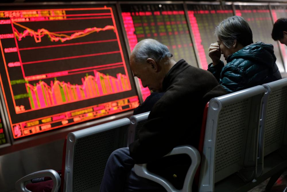 Chinese shares make modest gains after Monday rout<br />epa05088128 Chinese investors look at a screen showing stock movements at a stock brokerage house in Beijing, China, 05 January 2016. Shares in China made modest gains 05 January morning, the day after a plunge in the market triggered a halt to trading. The CSI 300 Index was up 0.79 per cent when the market shut for its lunch break. The index comprises 300 shares from the biggest companies on the Shanghai and Shenzhen exchanges. EPA/HOW HWEE YOUNG