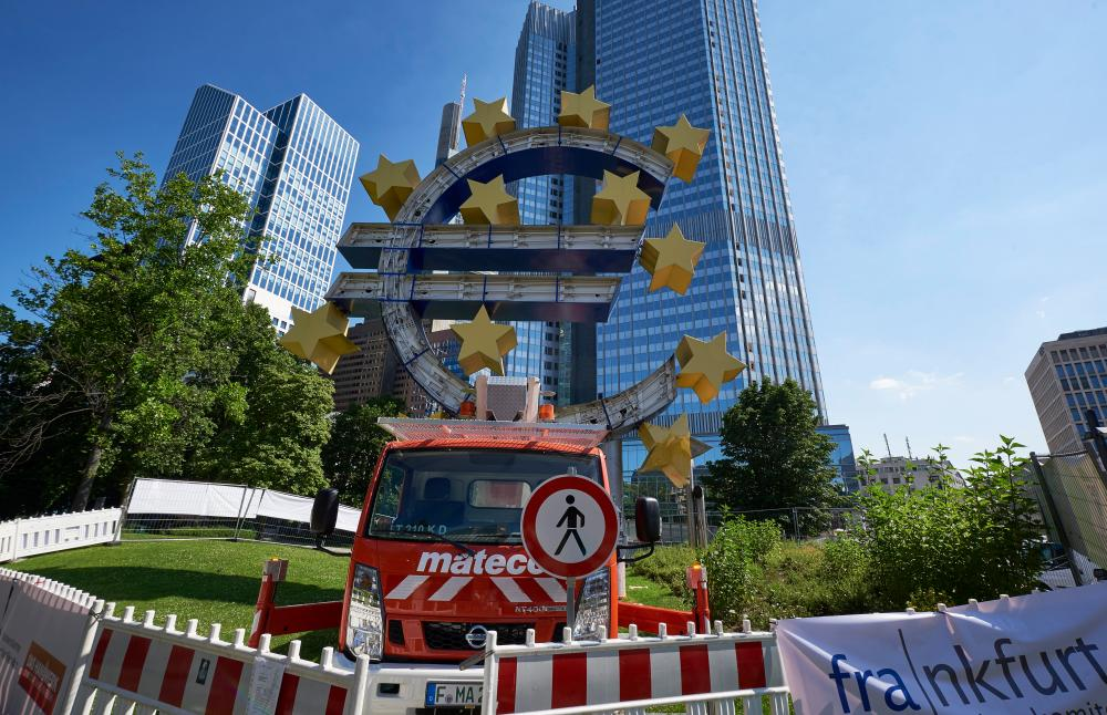 The Euro symbol in Willy Brandt Square, Frankfurt, on the first day of its restoration. The euro symbol will go through a four days restoration, starting on the day after Greece have voted 'No' to the EU, the ECB and the IMF policies, generating uncertainties on the monetary sign future. --- Image by © Horacio Villalobos/Corbis