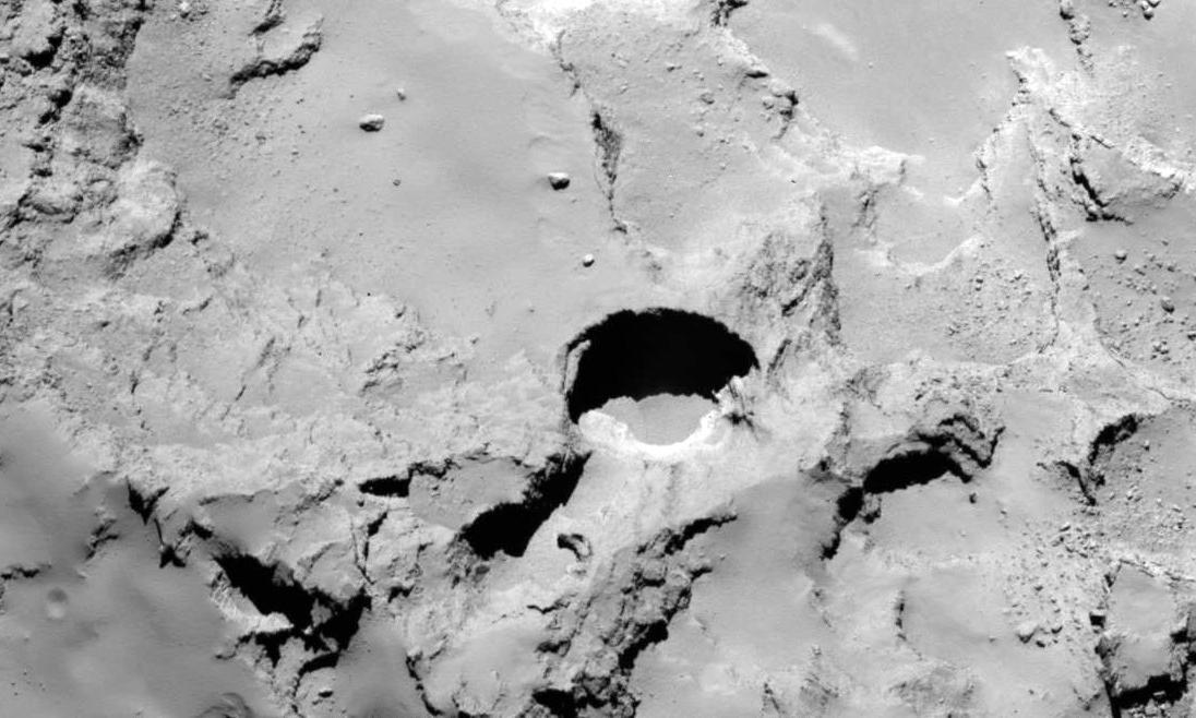 Rosetta spacecraft spots enormous sinkholes on comet 67P