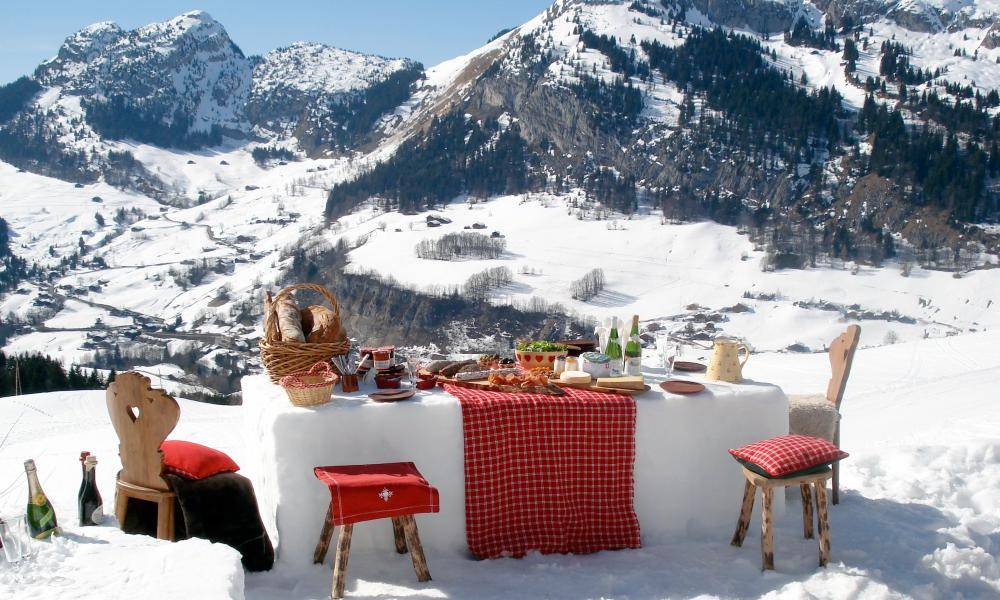 Lunch alfresco in the snow at La Ferme du Soleil, part of the White Chalet Collection.