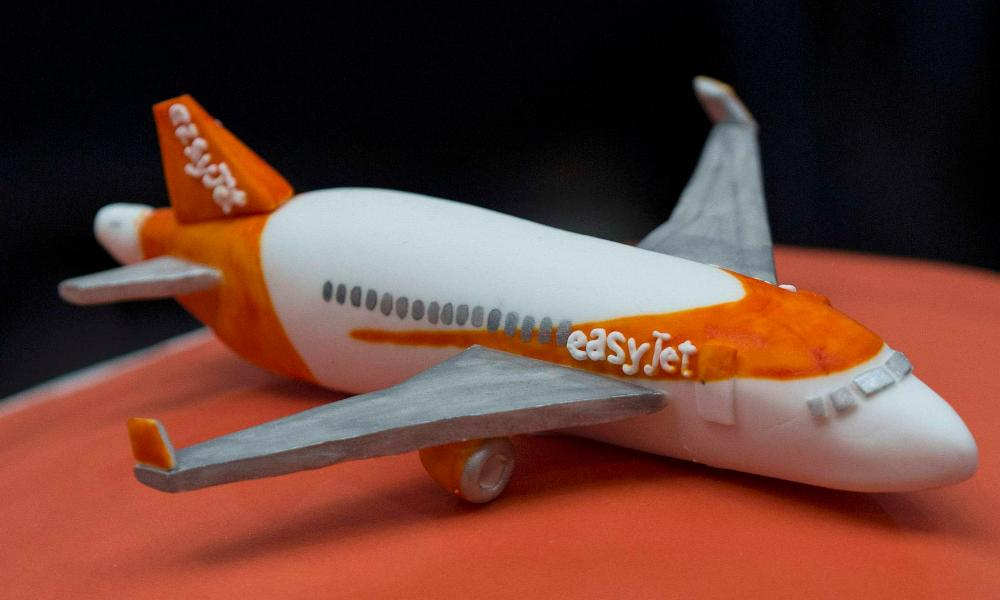 A cake is seen during an Easyjet media event to celebrate 20 years in business at Luton Airport, southern England, November 10, 2015. British low cost carrier easyJet said it would launch a loyalty scheme for its most frequent travelers, the latest perk to be added that is more usually associated with traditional airlines. At an event marking 20 years since its first flight on Tuesday, easyJet said it would reward customers who fly with it more than 20 times a year by offering them benefits such as flight changes for free. REUTERS/Eddie Keogh