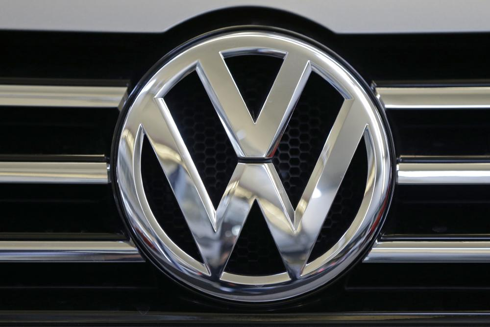 FILE - In this Feb. 14, 2013, file photo, a Volkswagen logo is seen on the grill of a Volkswagen on display in Pittsburgh. New Mexico is suing Volkswagen and other German automakers over an emissions cheating scandal that involves millions of cars worldwide, the first state to do so but almost certainly not the last. (AP Photo/Gene J. Puskar, File)