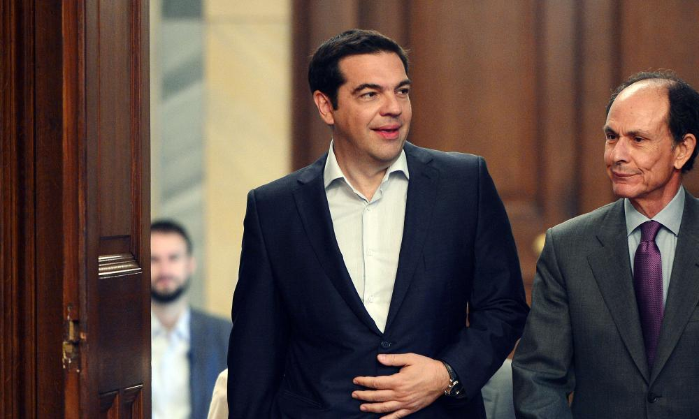 Tsipras arrives for the meeting.