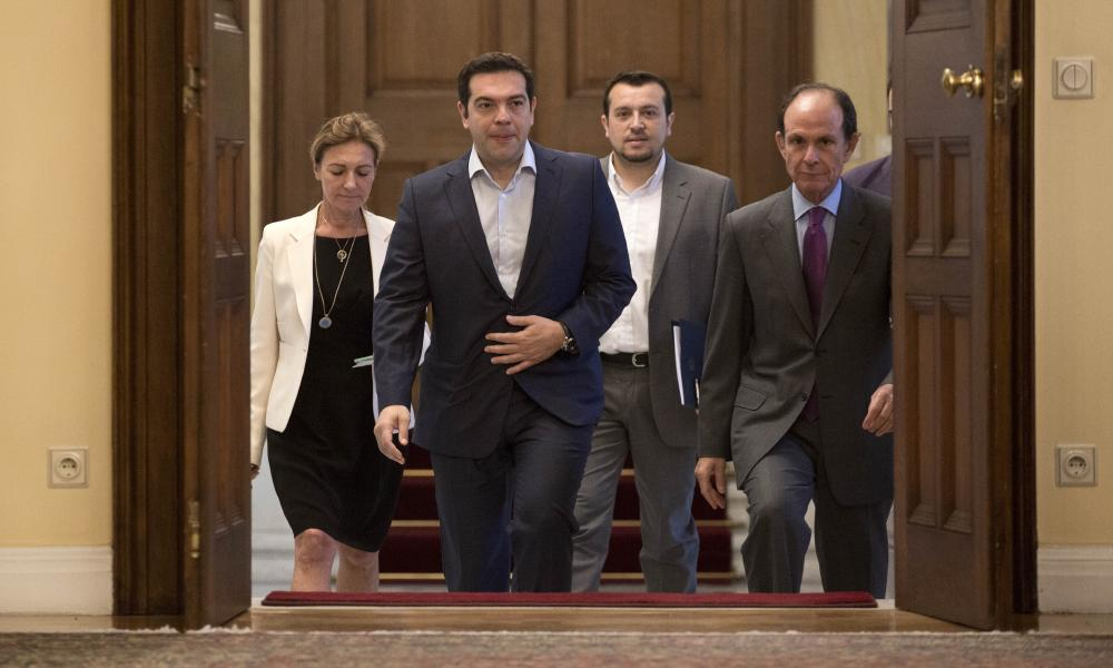 Greek Prime Minister Alexis Tsipras, second from right, arrives for a Greek political leaders meeting in Athens this morning.