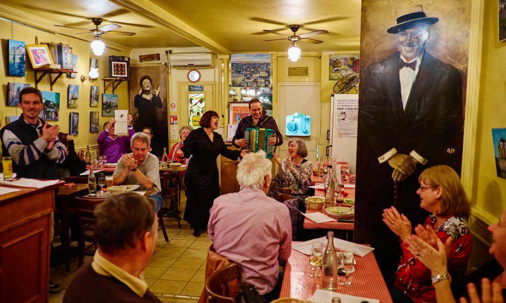 A singer and accordion player entertain guests at Restaurant Le Vieux Belleville, 12 rue Envierges, 75020 Paris, France