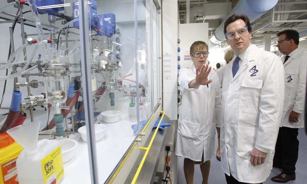 Chancellor George Osborne is with shown around by staff member Jan Milton-Edwards during a visit to the Macclesfield AstraZeneca site in Cheshire.