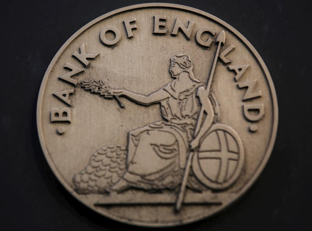 "File photo of the logo as seen at the Bank of England in the City of London<br />The logo is seen at the Bank of England in the City of London, Britain in this January 16, 2014 file photo. The Bank of England is expected to make an interest rate decision this week. REUTERS/Luke MacGregor/FilesGLOBAL BUSINESS WEEK AHEAD PACKAGE – SEARCH ""BUSINESS WEEK AHEAD OCTOBER 5"" FOR ALL 29 IMAGES"" width=""1000″ height=""742″ class=""gu-image"" /> </figure> <p><strong>Over at the Bank, they'll be putting the finishing touches to their announcements — we can expect some rapidfire tweeting once the clock strikes 12.</strong></p> <p>That's also the moment that economics correspondents are released from their lock-in. Fleet Street's finest have been confined in the Bank this morning, getting an early peek at the Inflation Report. </p> <p>My colleague <strong>Katie Allen</strong> is in Guardian colours….</p> </p></div> <p class="