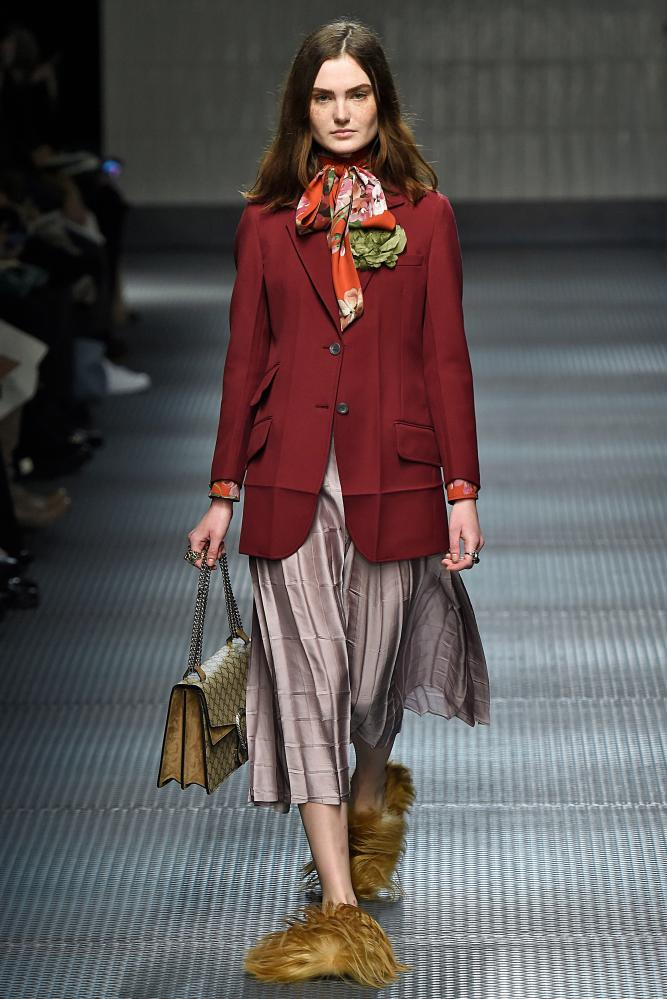 Modelling the slippers at Milan fashion week.