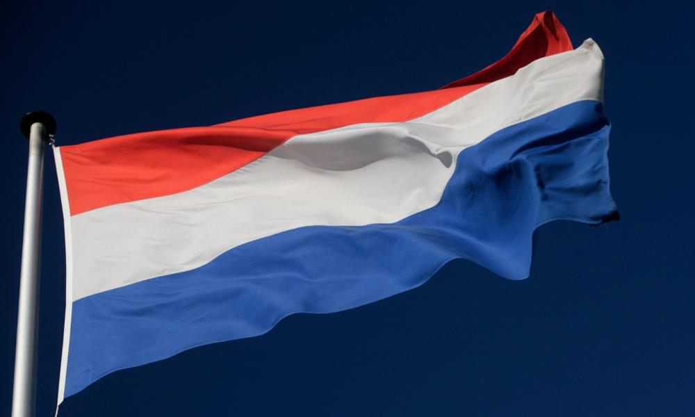 The Dutch flag flies outside the ING head office in Amsterdam, Netherlands, Monday Oct. 20, 2008.
