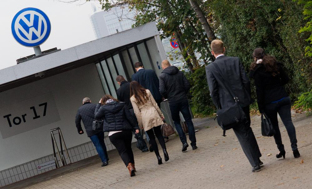 Volkswagen<br />06 Oct 2015, Wolfsburg, Germany --- VW employees enter the Volkswagen factory site through Gate 17 in Wolfsburg, Germany, 06 October 2015. Photo: JULIAN STRATENSCHULTE/dpa --- Image by © Julian Stratenschulte/dpa/Corbis