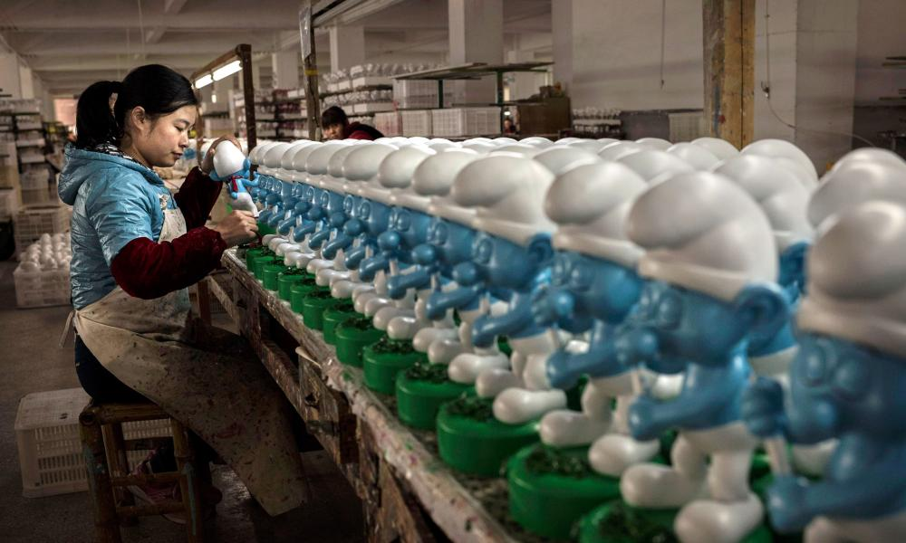 Ceramic Smurfs at a factory in Fujian province, China. The practice of taking money out of the country is known as 'Smurfing'.