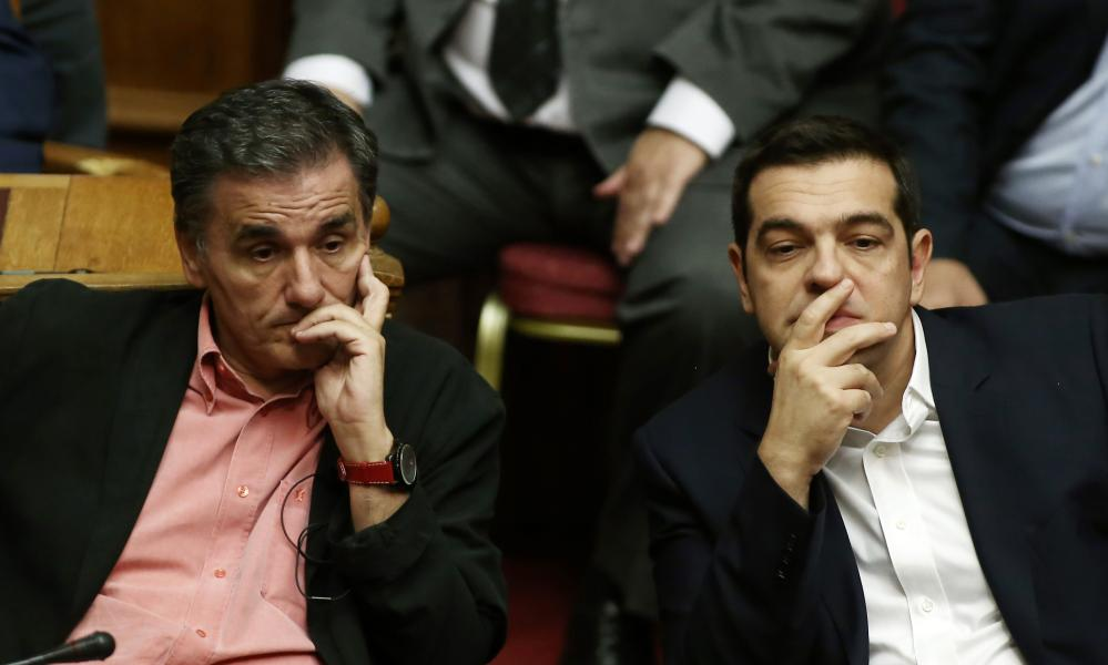 Finance minister Euclid Tsakalotos and prime minister Alexis Tsipras in parliament on Friday.