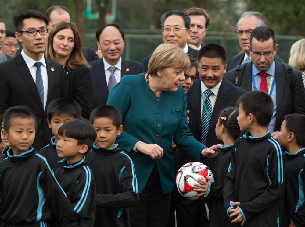 German Chancellor Angela Merkel visits China<br />epa05003214 German chancellor Angela Merkel (C) visits a physical education class in Xin Nan Cun, China, 30 October 2015. Merkel is on a two-day official visit to China. EPA/SOEREN STACHE