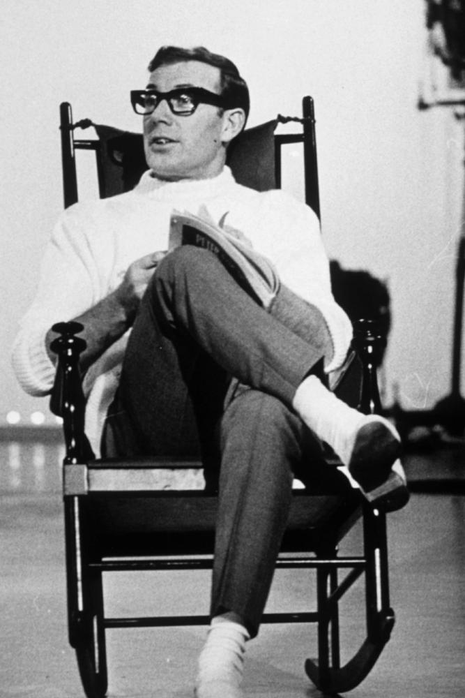 Val Doonican in rocking chair.