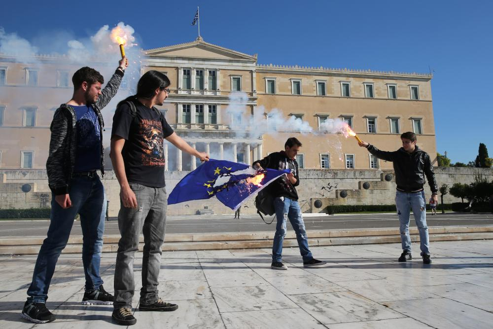 University students holding flares burn a European flag outside the Greek parliament during a protest in central Athens last Thursday.