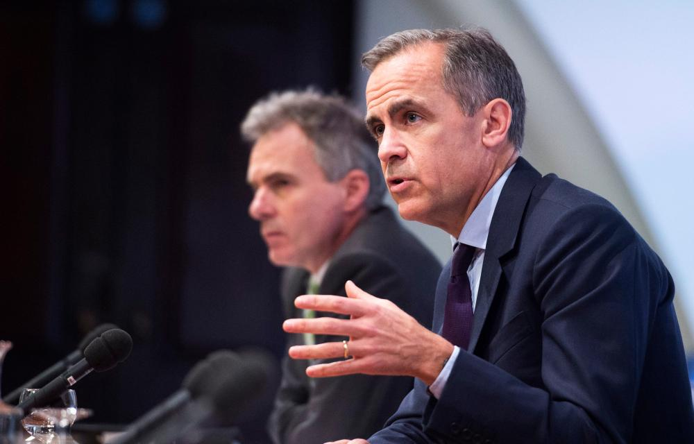 Bank of England Inflation Report Press Conferenceepa05142914 Bank of England Governor Mark Carney speaks during a press conference at the Bank of England in London, Britain, 04 February 2016. The Bank of England has cut its prediction for growth for 2016 from 2.5 per cent to 2.2 per cent and has decided to keep interest rates at 0.5 per cent. EPA/WILL OLIVER