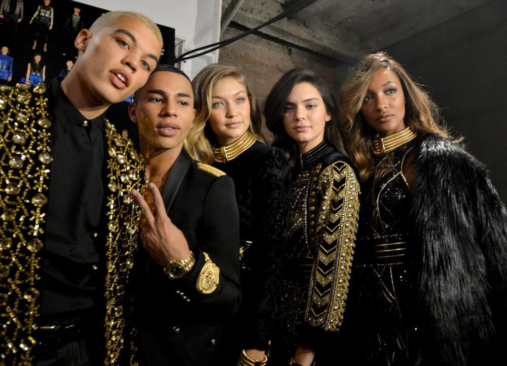 Models Dudley O'Shaughnessy, Gigi Hadid, Kendall Jenner and Jourdan Dunn pose with Olivier Rousteing, creative director of Balmain, backstage at the Balmain x H&M launch