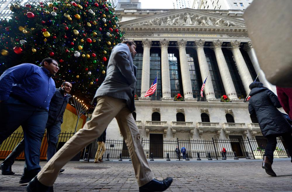 U.S.-NEW YORK-STOCKS-NYSE<br>17 Dec 2015, New York State, USA --- (151216) -- NEW YORK, Dec. 16, 2015 (Xinhua) -- Pedestrians walk in front of the New York Stock Exchange (NYSE), in New York, the United States, on Dec. 16, 2015. U.S. stocks rallied for the third straight day Wednesday, as the U.S. Federal Reserve decided to raise interest rates for the first time in nearly a decade. The Dow jumped 1.28 percent, and the S&P 500 leapt 1.45 percent, while the Nasdaq soared 1.52 percent. (Xinhua/Wang Lei) --- Image by © Wang Lei/Xinhua Press/Corbis