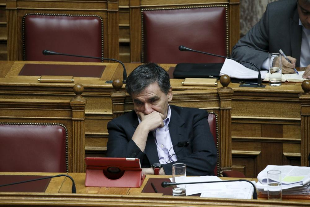 Greek Finance Minister Tsakalotos attends a parliamentary session before a vote on a set of reforms<br>Greek Finance Minister Euclid Tsakalotos attends a parliamentary session before a vote on a set of reforms needed for Greece to receive 1 billion euros in further bailout aid in Athens, Greece, December 15, 2015. REUTERS/Alkis Konstantinidis