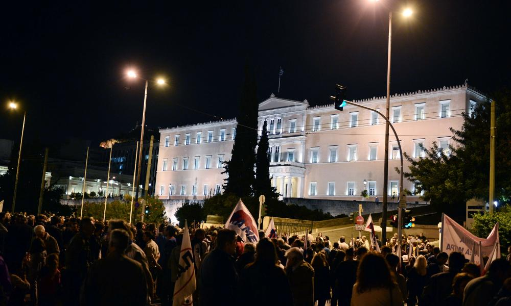 Protesters at a rally in front of the Greek parliament in Athens as MPs voted for reforms.