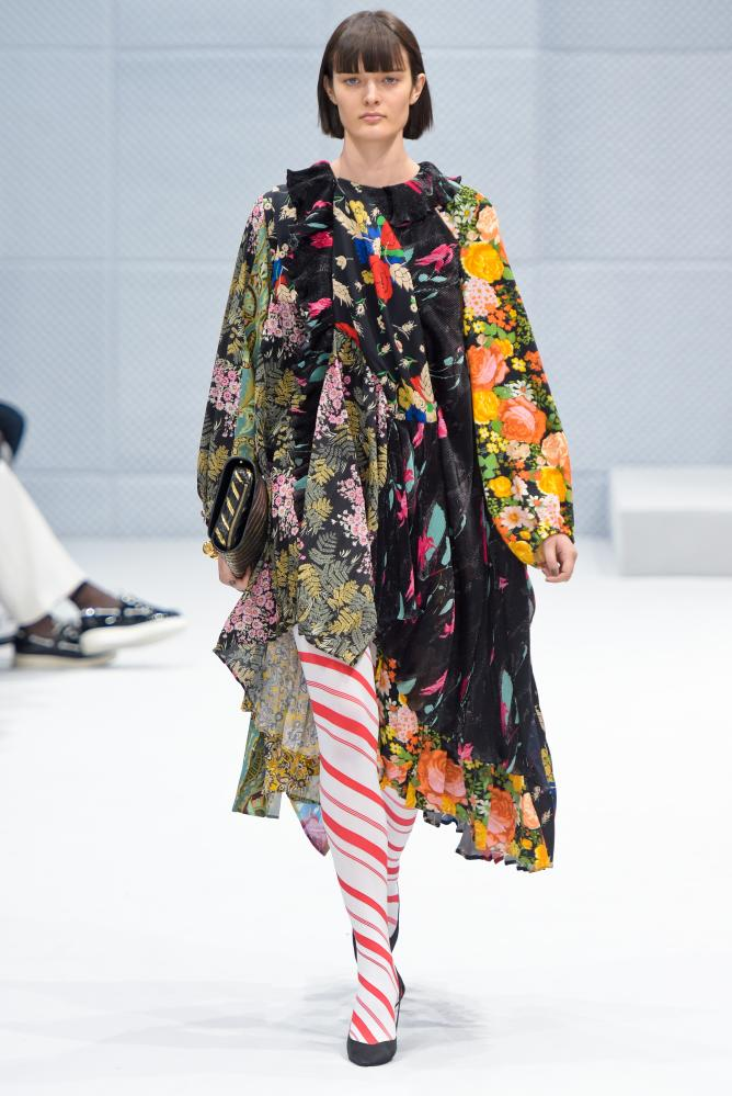 Model on catwalk in multicoloured clothes