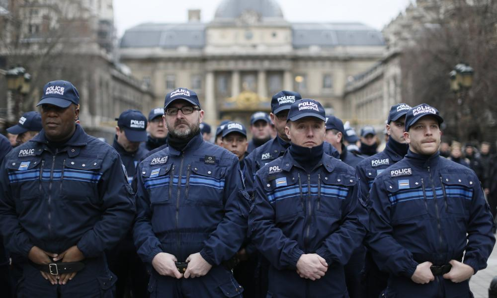 French municipal Police officers watch the French president pays tribute to the police officers.
