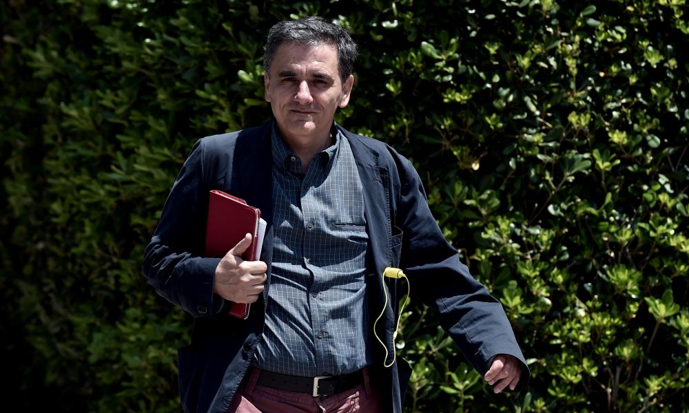 (FILES) In this file picture taken on June 15, 2015 Greek minister of International Economic Relations Euclidis Tsakalotos arrives for a meeting at the Prime minister's office in Athens. Greece on July 6, 2015 named economist Euclid Tsakalotos, its top negotiator in the stalled EU-IMF talks, as the country's new finance minister, the president's office said. AFP PHOTO / ARIS MESSINISARIS MESSINIS/AFP/Getty Images