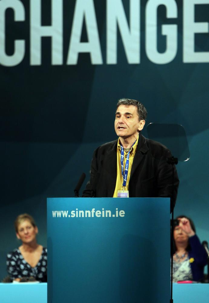 (FILES) In this file picture taken on March 7, 2015 guest speaker Euclid Tsakalotos of Greek Syriza party addresses the Republican party Sinn Fein annual conference in Londonderry, Northern Ireland. Greece on July 6, 2015 named economist Euclid Tsakalotos, its top negotiator in the stalled EU-IMF talks, as the country's new finance minister, the president's office said. AFP PHOTO / PAUL FAITHPAUL FAITH/AFP/Getty Images